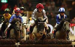 Rocco Dettori (centre in grey colours) wins the Osborne refrigerators shetland Pony Grand National during day four of the London International Horse Show at London Olympia.
