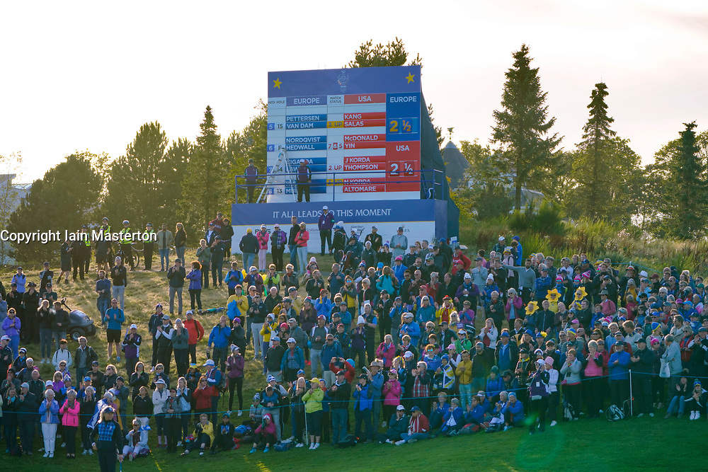 Solheim Cup 2019 at Centenary Course at Gleneagles in Scotland, UK. Large crowd of spectators in front of scoreboard during Friday afternoon fourballs.
