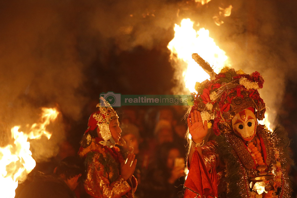 November 22, 2018 - Lalitpur, Nepal - A Nepalese artist dressed as Lord Narsimha performs during Kartik Nach festival at midnight in Lalitpur. The religious dance is performed over ten days in the Nepalese calendar known as Kartik to thank Lord Kumara for his protection. The devout King Siddhi Narsingh Malla first established the Kartik Nach in the 17th century. (Credit Image: © Skanda Gautam/ZUMA Wire)
