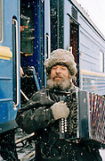 Accordian player busking by the Trans Siberian Railway, Siberia, Russia