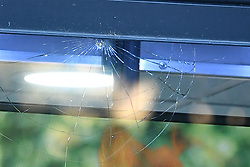 © Licensed to London News Pictures. 21/08/2018. London, UK. A bullet hole in the window of Chicken Cottage, at the scene of a double shooting in Rayners Lane, Harrow, north London. Armed police are reported to be searching the area after two men were shot in broad daylight. Their condition is unknown. This follows two separate shooting incidents in London yesterday. Photo credit: Ben Cawthra/LNP