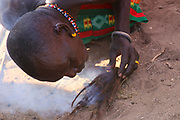 Samburu Maasai man lights a fire Samburu Maasai an ethnic group of semi-nomadic people Photographed in Samburu, Kenya