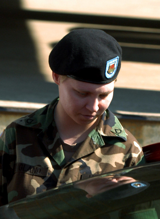 FORT BRAGG, NC- AUGUST 7: Pfc. Lynndie England leaves Saturday's hearing at the Staff Judge Advocate Building on Fort Bragg in Fayetteville, NC on 8/7/04 for her Article 32 investigation hearing.  England is charged with several counts, including one specification of conspiring to commit maltreatment of an Iraqi detainee, three specifications of assault against Iraqis, and several others. (Photo by Logan Mock-Bunting)