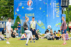 Fans play football at the Paris Fanzone, while waiting for the next game to start on the big screens. Images from the UEFA EURO 2016, 14 June 2016 in Fan Zone. (c) Paul Roberts   Edinburgh Elite media. All Rights Reserved