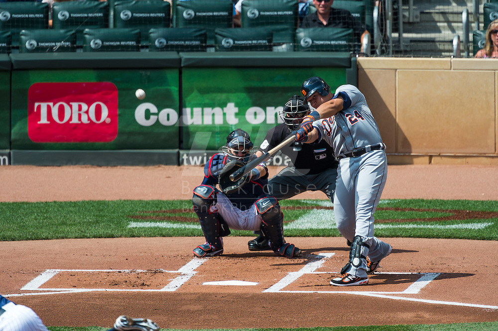 Miguel Cabrera (24) of the Detroit Tigers connects for his 30th home run of the season during the first inning of a game against the Minnesota Twins on August 15, 2012 at Target Field in Minneapolis, Minnesota.  The Tigers defeated the Twins 5 to 1.  Photo: Ben Krause