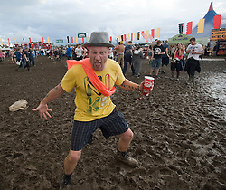 © Licensed to London News Pictures. 26/08/2011. Reading, UK. A mud covered Day one of Reading Festival 2011 in Reading, Berkshire today (26/08/2011). Photo credit: Ben Cawthra/LNP