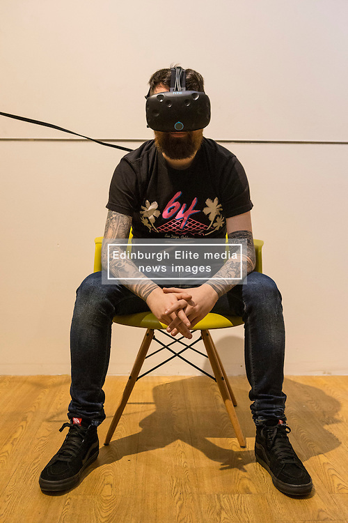 Scotland's first virtual reality arcade. E-VR opens on December 1 at Ocean Terminal, Edinburgh. It offers a variety of virtual reality  (VR) experiences and games. <br /> <br /> Pictured:  Dave Taylor showcasing an HTC Vive headset.