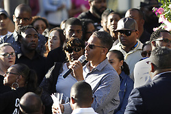 May 3, 2017 - San Diego, CA, USA - A candlelight vigil was held for the victim's of Sunday afternoon's shooting in University City in San Diego, where a gunman shot eight, killed Monique Clark and then was shot dead by police when he engaged them.   Pastor Miles McPherson of the Rock Church spoke to family, friends and the public who attended. (Credit Image: © John Gastaldo via ZUMA Wire)