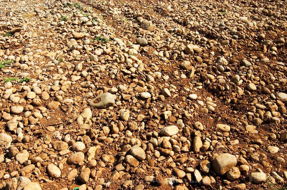 Typical red reddish clay sand sandy soil mixed with pebbles rocks stones in varying amount. Vineyard on the plain near Mostar city. Hercegovina Vino, Mostar. Federation Bosne i Hercegovine. Bosnia Herzegovina, Europe.