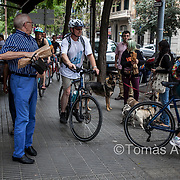 A local is startled by a group of passing tourists on a guided bike city tour.
