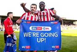 Harry Toffolo and John Akinde of Lincoln City celebrate winning promotion from Sky Bet League Two to Sky Bet League One - Mandatory by-line: Robbie Stephenson/JMP - 13/04/2019 - FOOTBALL - Sincil Bank Stadium - Lincoln, England - Lincoln City v Cheltenham Town - Sky Bet League Two