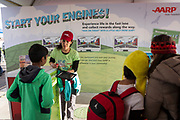 Daniela Romero sets a player for augmented reality at the AARP Block Party at the Albuquerque International Balloon Fiesta in Albuquerque New Mexico USA on Oct. 7th, 2018.
