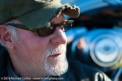 Former Harley dealer Erik Dunk of Adams Center, NY next to his 2003 Springer Softail at the AMCA swap meet in New Smyrina, FL during Daytona Bike Week, FL., USA. March 8, 2014.  Photography ©2014 Michael Lichter.