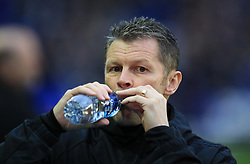 Birmingham City's manager Steve Cotterill drinks a bottle of water