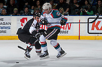 KELOWNA, CANADA - FEBRUARY 10: Ryan Jones #21 of the Vancouver Giants stick checks Dillon Dube #19 of the Kelowna Rockets during first period on February 10, 2017 at Prospera Place in Kelowna, British Columbia, Canada.  (Photo by Marissa Baecker/Shoot the Breeze)  *** Local Caption ***