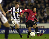 Photo. Richard Lane.<br />West Bromwich Albion v Manchester United. Carling Cup 4th Rd. 03/12/2003.<br /><br />Manchester's Kieran Richardson looks to beat West Brom's James O'Connor.