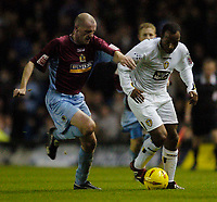 Photo. Jed Wee. Digitalsport<br /> Leeds United v Burnley, Coca-Cola Championship, 03/11/2004.<br /> Burnley's John McGreal (L) tries to keep Leeds' Julian Joachim in check.