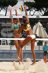 12-06-2012 VOLLEYBAL: WORLD TOUR BEACHVOLLEYBAL SMART GRAND SLAM: ROME <br /> (L-R) Liliane Maestrini, nr. 2 BRA green, Raquel Pellucci, nr. 2 BRA yellow<br /> ©2012-FotoHoogendoorn.nl / Pim Waslander