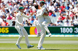 Australia's Josh Hazelwood celebrates with Nathan Lyon after he took the wicket of England's Joe Root during day five of the Ashes Test match at the Adelaide Oval, Adelaide.