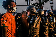 Paris, France, 03/06/20 | A standoff between a Black Lives Matter protester and French riot police.
