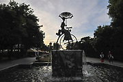 A statue of a woman riding a Penny Farthing bicycle. Photographed in Batumi, Georgia