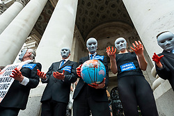 """© Licensed to London News Pictures. 27/08/2021. LONDON, UK.  Climate activists from Extinction Rebellion with masks protest outside the Bank of England in The City of London.  The event is part of the 'Impossible Rebellion' protest to """"target the root cause of the climate and ecological crisis"""" and are ongoing for two weeks until the Government agrees to stop all new fossil fuel investments.  Photo credit: Stephen Chung/LNP"""