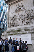 Workmates and friends enjoy after work drinks beneath Monument, the site near where the Great Fire of London started in 1666, on 2nd September 2021, in London, England.