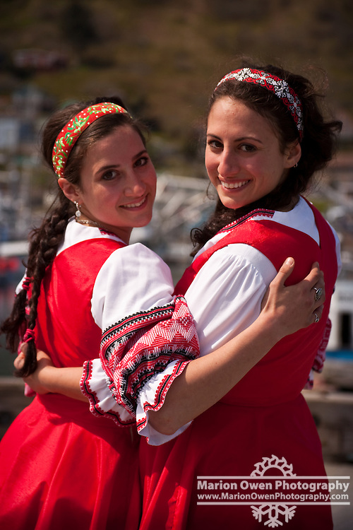 Portrait of sisters dressed in costumes for ethnic folk dance routine performed during annual Crab Festival in Kodiak, Alaska; spring