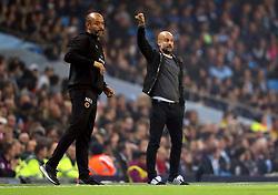 Wolverhampton Wanderers manager Nuno Espirito Santo and Manchester City manager Pep Guardiola (background)