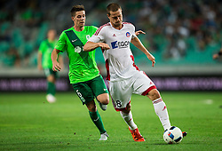 Miha Zajc of NK Olimpija vs James Lawrence of AS Trencin during 1st Leg football match between NK Olimpija Ljubljana (SLO) and FK AS Trenčin (SVK) in Second Qualifying Round of UEFA Champions League 2016/17, on July 13, 2016 in SRC Stozice, Ljubljana, Slovenia. Photo by Vid Ponikvar / Sportida