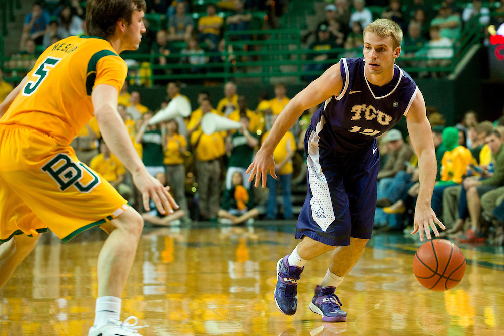 WACO, TX - JANUARY 11: Christian Gore #13 of the TCU Horned Frogs brings the ball up court against the Baylor Bears on January 11, 2014 at the Ferrell Center in Waco, Texas.  (Photo by Cooper Neill/Getty Images) *** Local Caption *** Christian Gore