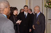 Chancellor Gerhard Schroder, Cherie Blair,Rt hon Tony Blair MP,  and Prof Phillip King President of the R.A.  at the opening of  Masterpieces from Dresden at the Royal Academy, London. 12 March 2003. © Copyright Photograph by Dafydd Jones 66 Stockwell Park Rd. London SW9 0DA Tel 020 7733 0108 www.dafjones.com
