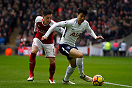 Son Heung-min of Tottenham Hotspur (R) in action with Mesut Ozil of Arsenal (L). Premier league match, Tottenham Hotspur v Arsenal at Wembley Stadium in London on Saturday 10th February 2018.<br /> pic by Steffan Bowen, Andrew Orchard sports photography.
