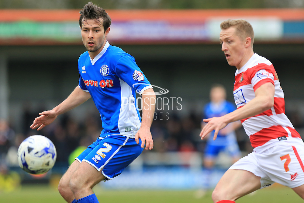 Joe Rafferty, Gary McSheffrey during the Sky Bet League 1 match between Rochdale and Doncaster Rovers at Spotland, Rochdale, England on 2 April 2016. Photo by Daniel Youngs.