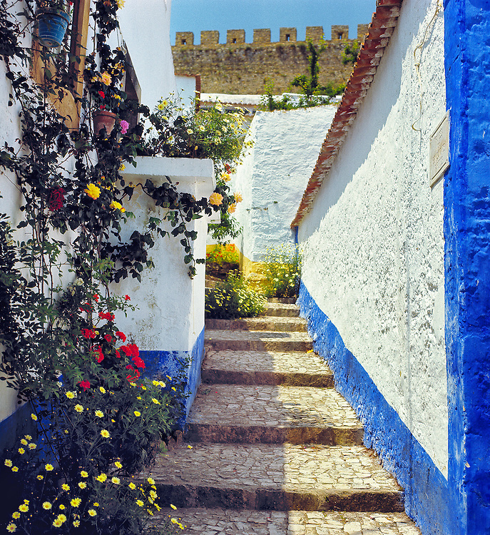 The white-washed village of Obidos, now a national monument, is built entirely within medieval walls.
