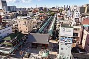 The Sensoji Buddhist temple, Thunder Gate, Nakamise dori shopping street and the five-storied pagoda in Asakusa, Tokyo, Japan.