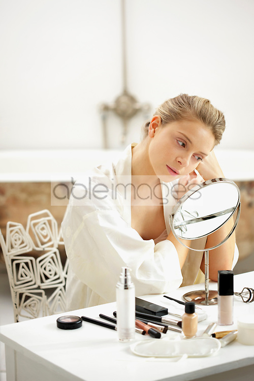 Woman at Dressing Table Looking in Mirror