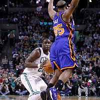 04 March 2012: New York Knicks point guard Baron Davis (85) jumps past Boston Celtics small forward Mickael Pietrus (28) during the first half of Boston Celtics vs the New York Knicks at the TD Garden, Boston, Massachusetts, USA.