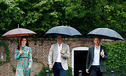 The Duke and Duchess of Cambridge and Prince Harry arrive for a visit to the White Garden in Kensington Palace, London, and to meet with representatives from charities supported by Diana, the Princess of Wales.