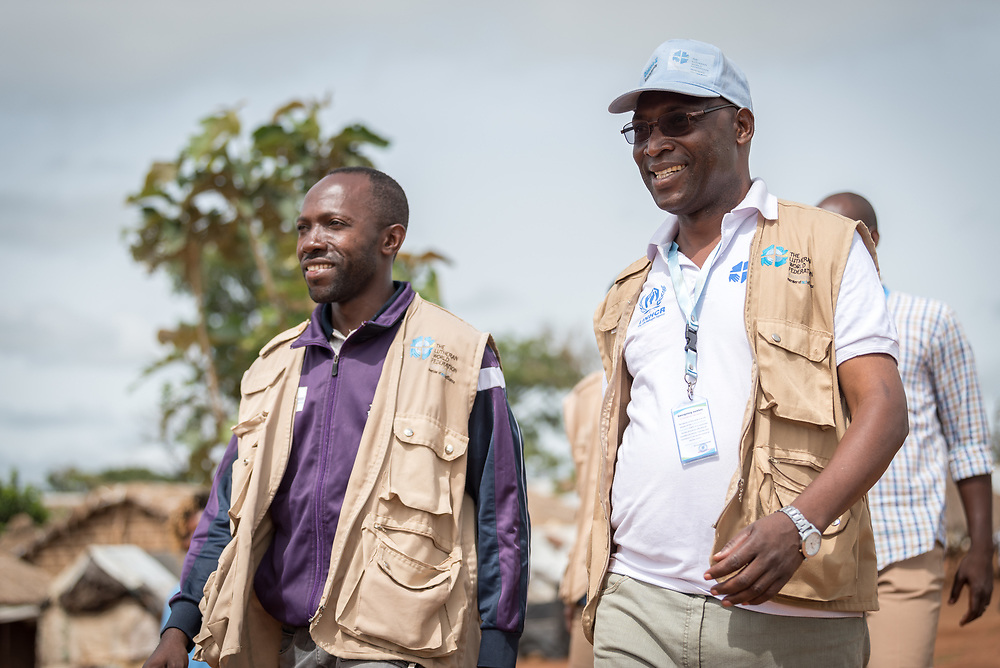 3 June 2019, Djohong, Cameroon: Staff of the Lutheran World Federation World Service programme walk through the Borgop refugee camp, under the leadership of Mathieu Idjawo (right), project coordinator of 'Strengthened Livelihoods and Social Cohesion for Central African Republic refugees and host communities in Cameroon'. The Borgop refugee camp is located in the municipality of Djohong, in the Mbere subdivision of the Adamaoua regional state in Cameroon. Supported by the Lutheran World Federation since 2015, the camp currently holds 12,300 refugees from the Central African Republic.