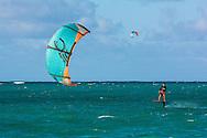 Foil Kitesurfing, that is on a hydrofoil board in Kailua Bay, Oahu, Hawaii