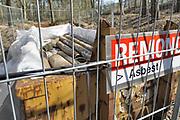 Nederland, Doetinchem, 22-3-2019In een afvalcontainer liggen asbest buizen klaar om ingepakt en afgevoerd te worden.Foto: Flip Franssen