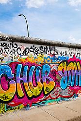 Graffiti on original section of Berlin Wall at East Side Gallery in Friedrichshain in Berlin Germany
