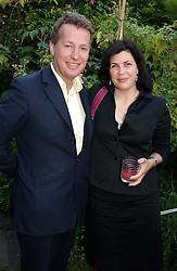 ORLANDO FRASER and TV presenter KIRSTIE ALLSOPP daughter of Lord Hindlip at a Conservative Party summer garden party hosted by Lord Hesketh and held at 7 Lansdowne Road, Notting Hill, London W11 on 28th June 2004.