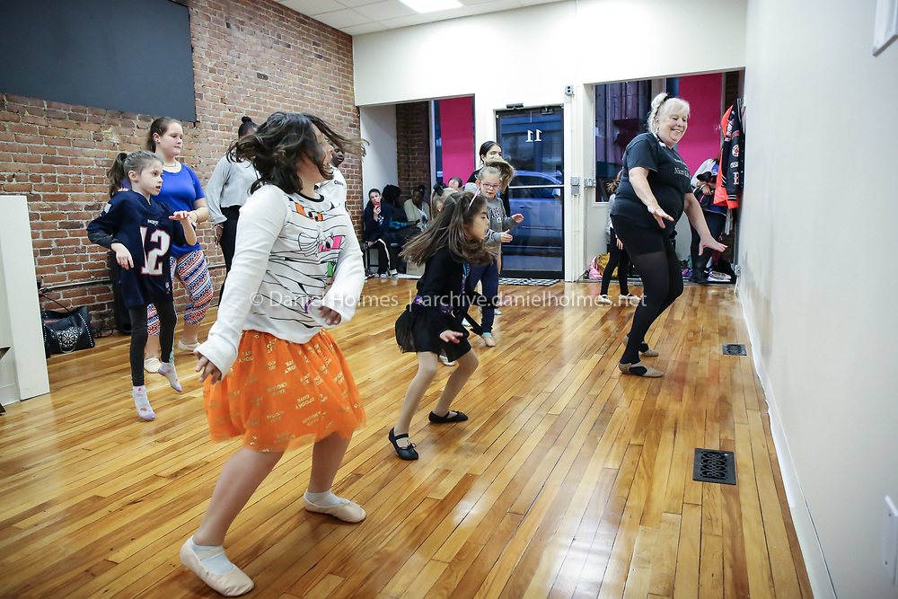 (10/21/19, NATICK, MA) Students dance with owner Nancy Kelley during dance class at Nancy Kelley Dance Studio in Natick on Monday. The business reopened almost three months to the day after a fire destroyed the business along with seven others in downtown Natick. [Daily News and Wicked Local Photo/Dan Holmes]
