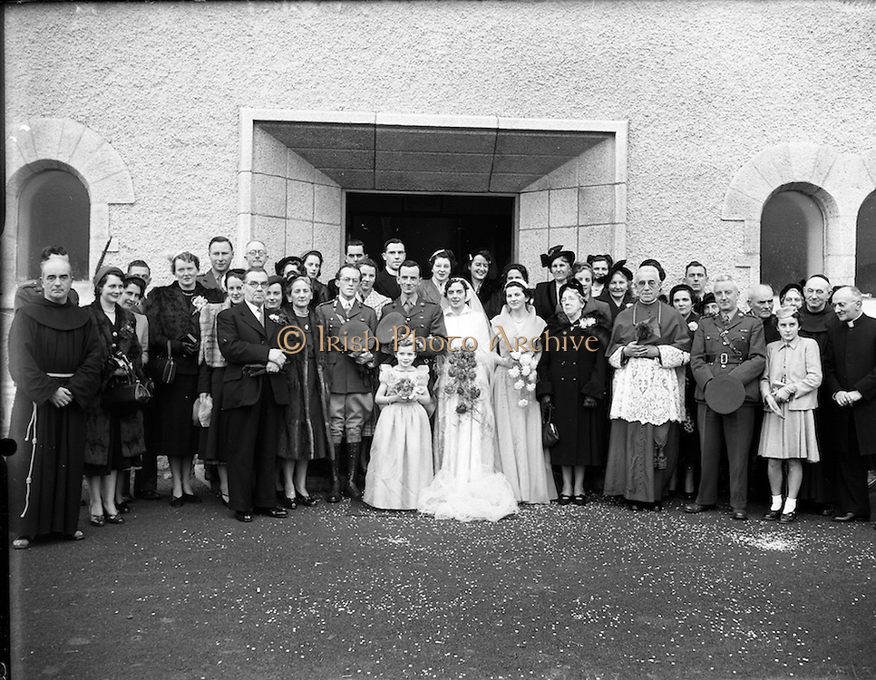 18/11/1952<br /> 11/18/1952<br /> 18 November 1952<br /> Wedding of Lieutenant Seamus Lillis, (son of Colonel James Lillis, Army Chief of Staff) Collins Barracks, Cork and Miss Aureed Mundy, Donegal at Ross Nuala and Bundoran, Co. Donegal. The wedding party outside the church at Ross Nuala. On the right can be seen the Bride's uncle Most Rev. Dr.   William MacNeely, Bishop of Raphoe and the Groom's father Col. James Lillis.