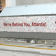 Kennedy Space Center employees signed a banner to wish the astronauts luck at the Kennedy Space Center Friday, July 8, 2011, in Cape Canaveral, Fla. Shuttle Atlantis is scheduled to launch on Friday, July 8 and is the 135th and final space shuttle launch for NASA..  (AP Photo/Alex Menendez)