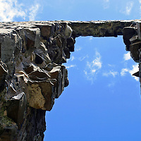 Europe, Ireland, Northern Ireland, Bushmills. Dunluce Castle arch and sky.