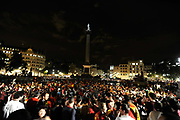 Spanish fans celebrate in Trafalgar Square in central London after Spain beat Holland in the final of the soccer world cup,July 11,2010. It is the first time in the country's history that they have won the trophy.
