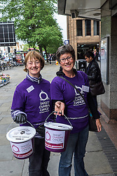 Two women charity workers collecting for Target Ovarian Cancer.